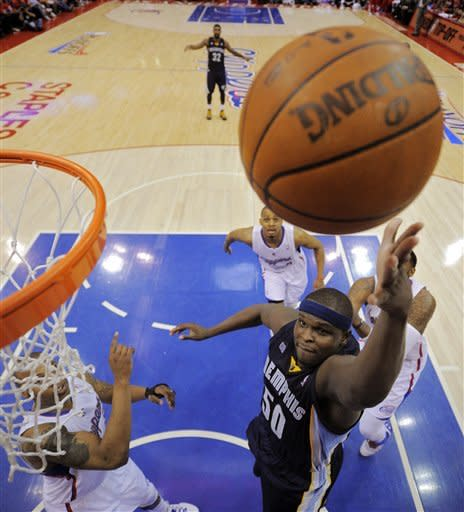 Memphis Grizzlies forward Zach Randolph, right, shoots as Los Angeles Clippers forward Caron Butler, left, defends during the first half of Game 3 in their first-round NBA basketball playoff series, Saturday, May 5, 2012, in Los Angeles. (AP Photo/Mark J. Terrill)