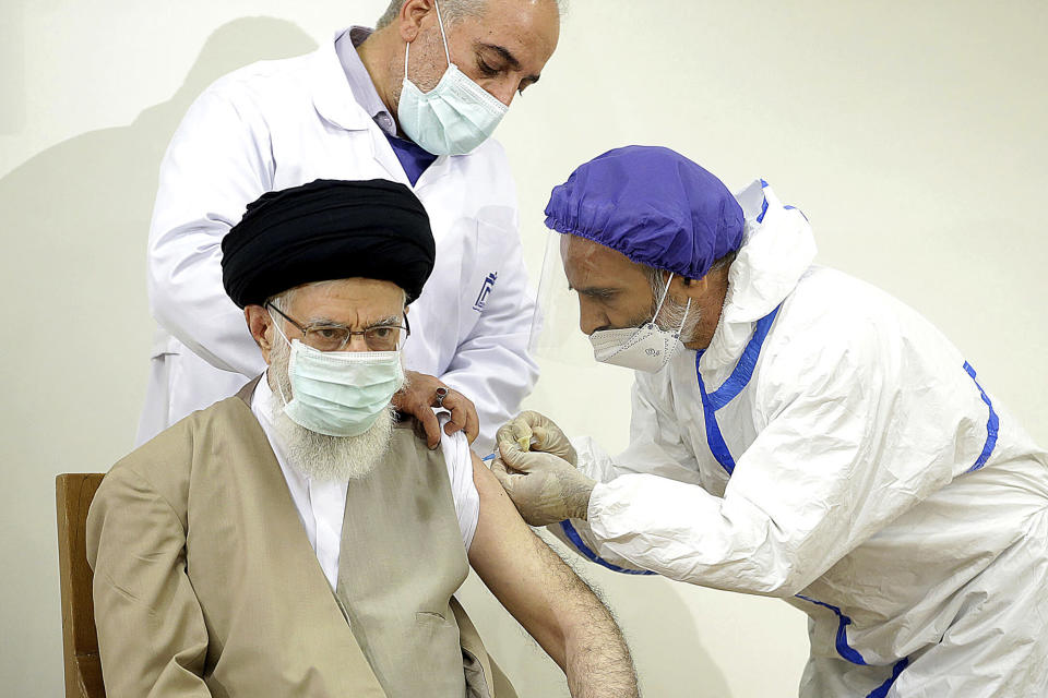 In this photo released by the official website of the Office of the Iranian Supreme Leader, Supreme Leader Ayatollah Ali Khamenei receives a shot of the Coviran Barekat COVID-19 vaccine in Tehran, Iran, Friday, June 25, 2021. (Office of the Iranian Supreme Leader via AP)