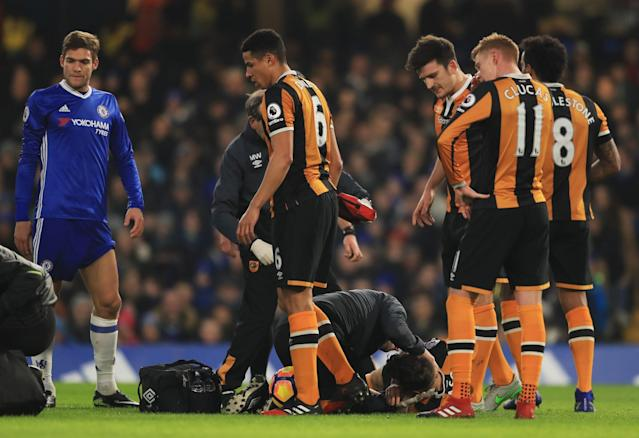<p>Ryan Mason and Gary Cahill go down after a collision of heads </p>