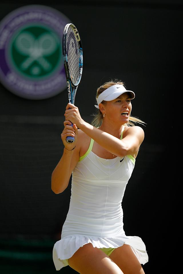 LONDON, ENGLAND - JUNE 29:  Maria Sharapova of Russia returns the ball during her Ladies' singles third round match against Su-Wei Hsieh of Taipei on day five of the Wimbledon Lawn Tennis Championships at the All England Lawn Tennis and Croquet Club on June 29, 2012 in London, England.  (Photo by Paul Gilham/Getty Images)