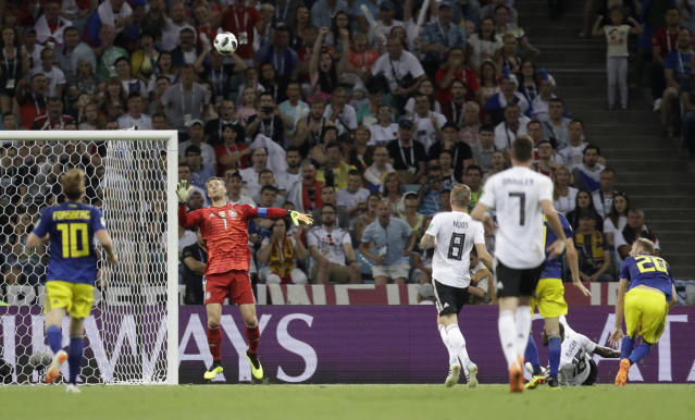 Sweden's Ola Toivonen, right, scores the opening goal during the group F match between Germany and Sweden at the 2018 soccer World Cup in the Fisht Stadium in Sochi, Russia, Saturday, June 23, 2018. (AP Photo/Michael Probst)