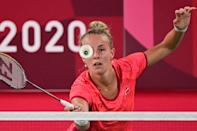 <p>Denmark's Mia Blichfeldt hits a shot to India's P. V. Sindhu in their women's singles badminton round of 16 match during the Tokyo 2020 Olympic Games at the Musashino Forest Sports Plaza in Tokyo on July 29, 2021. (Photo by Pedro PARDO / AFP)</p>