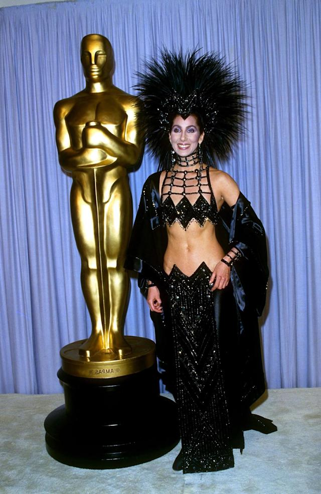<p>A reminder of why we miss seeing Cher on red carpets. This bejeweled look from Bob Mackie ruled the red carpet that year, and it lives in our hearts forever. (Photo: Rex) </p>