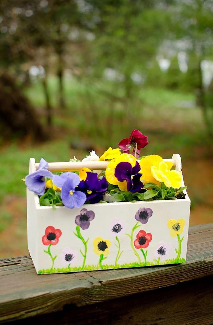 """<p>Moms love homemade gifts! Grab a <a href=""""https://www.target.com/p/hand-made-modern-wooden-crate-pine/-/A-16781461"""" rel=""""nofollow noopener"""" target=""""_blank"""" data-ylk=""""slk:wooden planter or crate"""" class=""""link rapid-noclick-resp"""">wooden planter or crate</a> and some <a href=""""https://www.amazon.com/Crayola-First-Fingerpaint-Washable-Paint/dp/B0197UC222/?tag=syn-yahoo-20&ascsubtag=%5Bartid%7C10050.g.19618668%5Bsrc%7Cyahoo-us"""" rel=""""nofollow noopener"""" target=""""_blank"""" data-ylk=""""slk:finger paint"""" class=""""link rapid-noclick-resp"""">finger paint</a>, and let your kiddo decorate away.</p><p><strong>Get the tutorial at <a href=""""http://www.5minutesformom.com/115693/mothers-day-craft-flower-thumbprint-planter/"""" rel=""""nofollow noopener"""" target=""""_blank"""" data-ylk=""""slk:5 Minutes For Mom"""" class=""""link rapid-noclick-resp"""">5 Minutes For Mom</a>. </strong></p><p><strong><a class=""""link rapid-noclick-resp"""" href=""""https://go.redirectingat.com?id=74968X1596630&url=https%3A%2F%2Fwww.walmart.com%2Fip%2FCrayola-My-First-Fingerpaint-Kit-Washable-Paint-Set-14-Pieces%2F987608617&sref=https%3A%2F%2Fwww.countryliving.com%2Fshopping%2Fgifts%2Fg19618668%2Fmothers-day-gifts-from-toddler%2F"""" rel=""""nofollow noopener"""" target=""""_blank"""" data-ylk=""""slk:SHOP FINGER PAINT"""">SHOP FINGER PAINT</a><br></strong></p>"""
