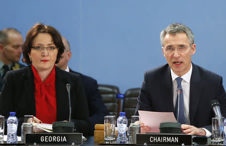 Georgia's Minister of Defence Tinatin Khidasheli (L) and NATO Secretary General Jens Stoltenberg (R) address a NATO-Georgia Commission defense ministers meeting at the Alliance's headquarters in Brussels February 11, 2016. REUTERS/Yves Herman