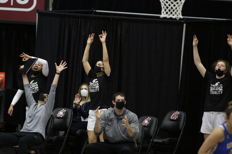 The Washington State bench cheers during the second half of an NCAA college basketball game against UCLA in Pullman, Wash., Friday, Feb. 5, 2021. (AP Photo/Young Kwak)
