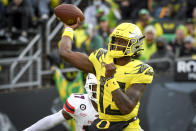 Oregon quarterback Anthony Brown (13) passes during the second quarter of an NCAA college football game against Stony Brook Saturday, Sept. 18, 2021, in Eugene, Ore. (AP Photo/Andy Nelson)