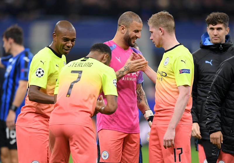 MILAN, ITALY - NOVEMBER 06: Kyle Walker of Manchester City has a laugh with Kevin De Bruyne, Raheem Sterling and Fernandinho of Manchester City following the UEFA Champions League group C match between Atalanta and Manchester City at Stadio Giuseppe Meazza on November 06, 2019 in Milan, Italy. (Photo by Michael Regan/Getty Images)