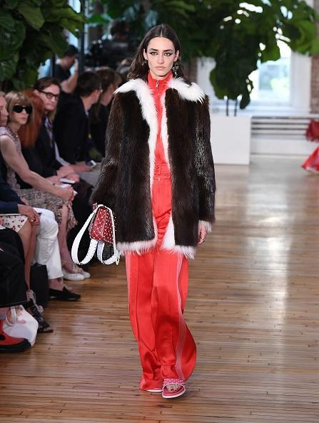 <p>A model walks the runway in a tracksuit and fur coat for the Valentino Resort 2018 runway show in New York City. (Photo: Getty Images) </p>