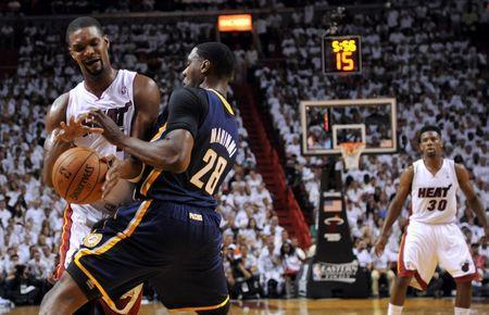 May 26, 2014; Miami, FL, USA; Miami Heat center Chris Bosh (1) battles with Indiana Pacers center Ian Mahinmi (28) for the ball in game four of the Eastern Conference Finals of the 2014 NBA Playoffs at American Airlines Arena. Mandatory Credit: Steve Mitchell-USA TODAY Sports