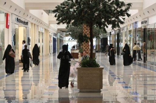 The Saudi religious police prevent women from driving and require them to be covered from head to foot in black