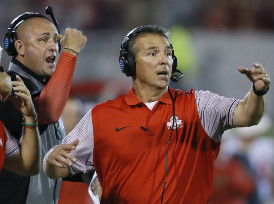 Ohio State coach Urban Meyer, right, and then-assistant coach Zach Smith, left, gesture from the sidelines during a game (AP)