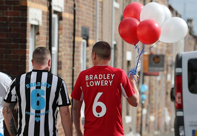 <p>Football fans united as they head towards Bradley's funeral </p>