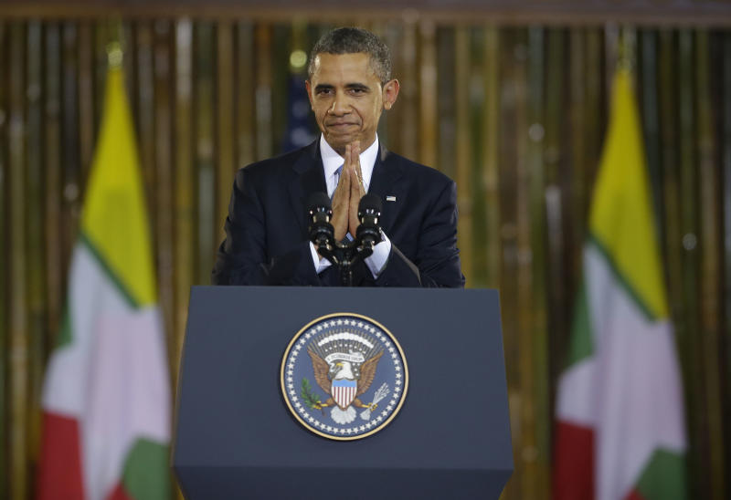 """U.S. President Barack Obama puts his hands together after the conclusion of his speech at Yangon University's Convocation Hall in Yangon, Myanmar, Monday, Nov. 19, 2012. In a historic trip to a long shunned land, Obama on Monday showered praise and promises of more U.S. help to Myanmar if the Asian nation keeps building its new democracy. """"Our goal is to sustain the momentum,"""" he declared with pride as the first U.S. president to visit here. (AP Photo/Pablo Martinez Monsivais)"""