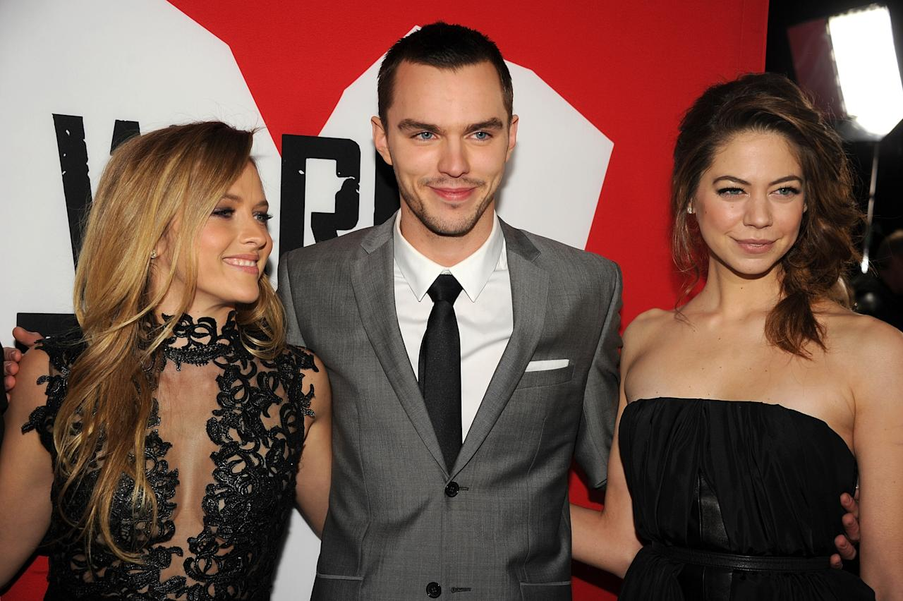 "HOLLYWOOD, CA - JANUARY 29:  (L-R) Actors Teresa Palmer, Nicholas Hoult and Analeigh Tipton arrive for the Los Angeles premiere of Summit Entertainment's ""Warm Bodies"" at ArcLight Cinemas Cinerama Dome on January 29, 2013 in Hollywood, California.  (Photo by Kevin Winter/Getty Images)"