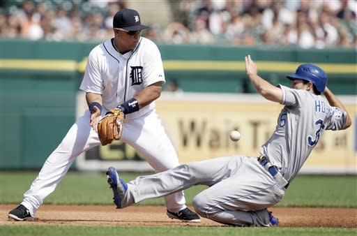Kansas City Royals' Eric Hosmer, right, beats the throw to Detroit Tigers third baseman Miguel Cabrera to advance from first base to third on a single by teammate Billy Butler in the first inning of a baseball game on Saturday, July 7, 2012, in Detroit. (AP Photo/Duane Burleson)