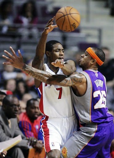 Detroit Pistons guard Brandon Knight (7) passes the ball against Phoenix Suns guard Shannon Brown (26) in the first half of an NBA basketball game, Wednesday, Nov. 28, 2012, in Auburn Hills, Mich. (AP Photo/Duane Burleson)