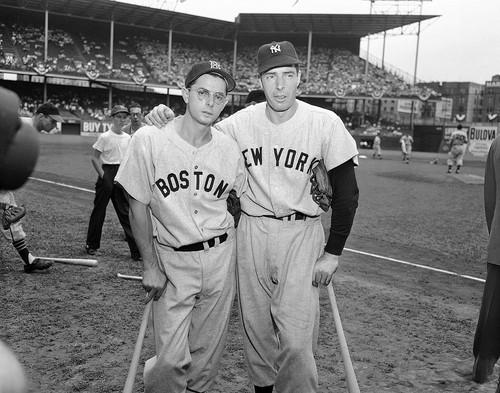 Dominic DiMaggio, left, seen in 1949, still holds the Boston Red Sox team record for the longest consecutive-game hitting streak, but was overshadowed by the towering legend of his brother Joe, the Yankee Clipper.