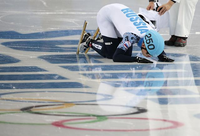 Victor An of Russia kisses the ice after placing first compete in a men's 1000m short track speedskating final at the Iceberg Skating Palace during the 2014 Winter Olympics, Saturday, Feb. 15, 2014, in Sochi, Russia. (AP Photo/Ivan Sekretarev)