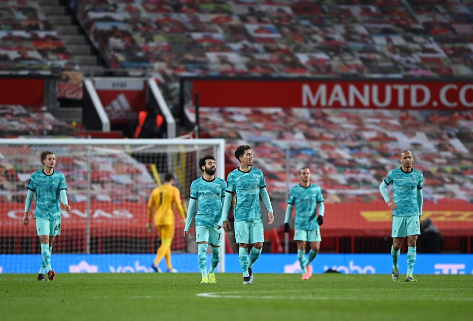Liverpool players look dejected after Manchester United's Bruno Fernandes scored the winning goal in their FA Cup fourth-round tie.