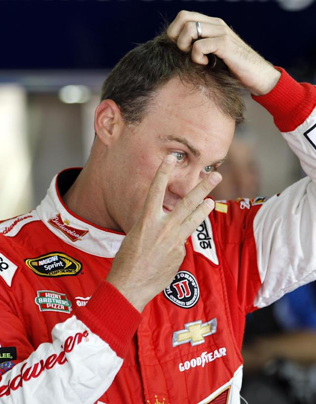 Kevin Harvick talks to a crew member before practice for Sunday's NASCAR Sprint Cup series Coca-Cola 600 auto race at Charlotte Motor Speedway in Concord, N.C., Thursday, May 22, 2014. (AP Photo/Terry Renna)