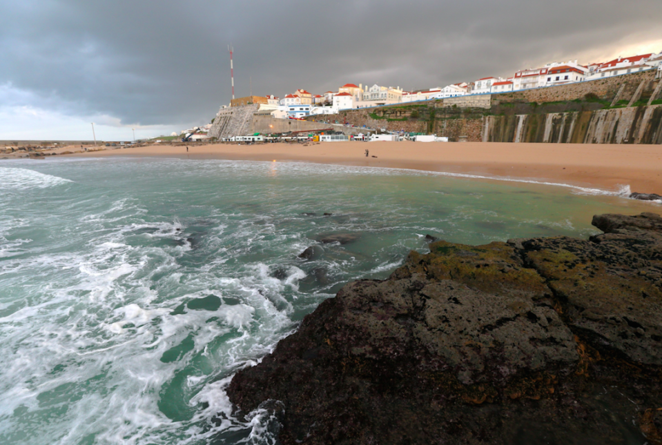 The couple fell 30m from a wall at Pescadores beach in Portugal (Picture: Rex)