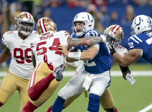 Indianapolis Colts quarterback Andrew Luck (12) is sacked by San Francisco 49ers defensive end Cassius Marsh (54) during the first half of an NFL preseason football game in Indianapolis, Saturday, Aug. 25, 2018. (AP Photo/AJ Mast)