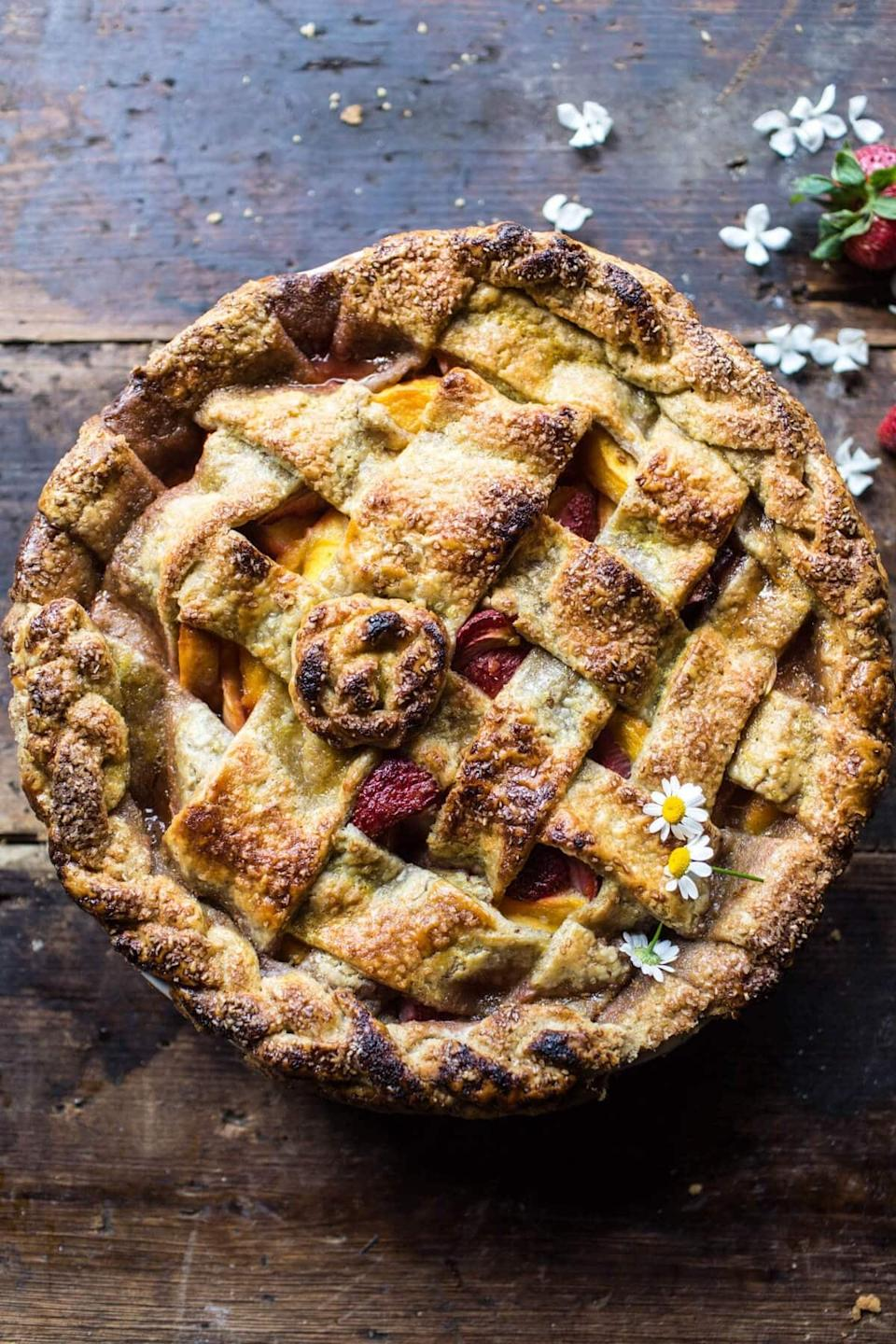 "<p>Fresh peaches and strawberries are mixed with toasted pecans, brown sugar, and honey to make this fresh berry pie. It's perfect for spring or summer, and can even be made in the colder months when you're craving bright and exciting flavors.</p> <p><strong>Get the recipe</strong>: <a href=""https://www.halfbakedharvest.com/honey-strawberry-peach-pie/"" class=""link rapid-noclick-resp"" rel=""nofollow noopener"" target=""_blank"" data-ylk=""slk:honey strawberry peach pie"">honey strawberry peach pie</a></p>"