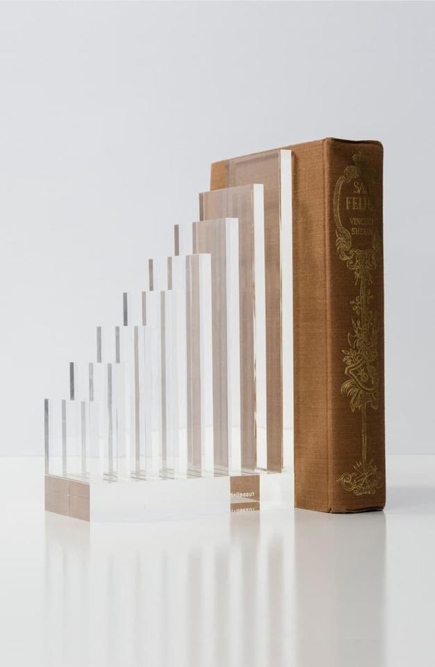 """<p>These <a href=""""https://www.popsugar.com/buy/Russell-Hazel-Organizer-Bookends-494362?p_name=Russell%20%2B%20Hazel%20Organizer%20Bookends&retailer=shop.nordstrom.com&pid=494362&price=48&evar1=tres%3Auk&evar9=25726813&evar98=https%3A%2F%2Fwww.popsugar.com%2Flove%2Fphoto-gallery%2F25726813%2Fimage%2F46679506%2FRussell-Hazel-Organizer-Bookends&list1=gifts%2Cbooks%2Choliday%2Cgift%20guide%2Creading%2Choliday%20living%2Cgifts%20for%20women%2Cgifts%20for%20men&prop13=api&pdata=1"""" rel=""""nofollow"""" data-shoppable-link=""""1"""" target=""""_blank"""" class=""""ga-track"""" data-ga-category=""""Related"""" data-ga-label=""""https://shop.nordstrom.com/s/russell-hazel-organizer-bookends/5136953?origin=keywordsearch-personalizedsort&amp;breadcrumb=Home%2FAll%20Results&amp;color=clear"""" data-ga-action=""""In-Line Links"""">Russell + Hazel Organizer Bookends</a> ($48) are so modern.</p>"""