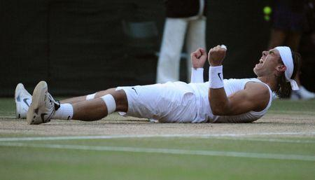 FILE PHOTO: Rafael Nadal of Spain celebrates defeating Roger Federer of Switzerland in their finals match at the Wimbledon tennis championships in London, Britain, July 6, 2008.  REUTERS/Toby Melville/File Photo