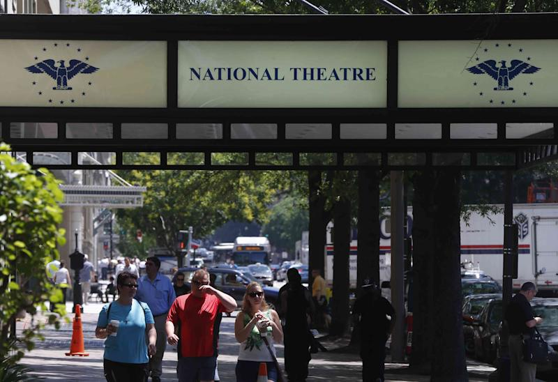 """The National Theater is seen in Washington, Friday, May 31, 2013. The oldest continuously operating theater in the nation's capital, once a regular stop for top performers and shows, is getting a fresh start after struggling for years. A new season of Broadway shows announced this week at the National Theatre includes its first world premiere of a new musical bound for Broadway in two decades with """"If/Then"""" starring Idina Menzel. The season also includes the return of """"West Side Story,"""" which got its start at the National in the 1950s and the Washington premiere of """"American Idiot"""" from the music group Green Day.(AP Photo/Charles Dharapak)"""