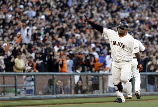 San Francisco Giants' Pablo Sandoval gestures after hitting a two-run home run off San Diego Padres' Andrew Cashner in the fourth inning of a baseball game on Saturday, April 20, 2013, in San Francisco. (AP Photo/Ben Margot)