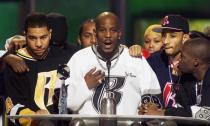 FILE PHOTO: Rapper DMX offers a prayer after winning the R&B Albums Artist of the Year award at the Billboar..