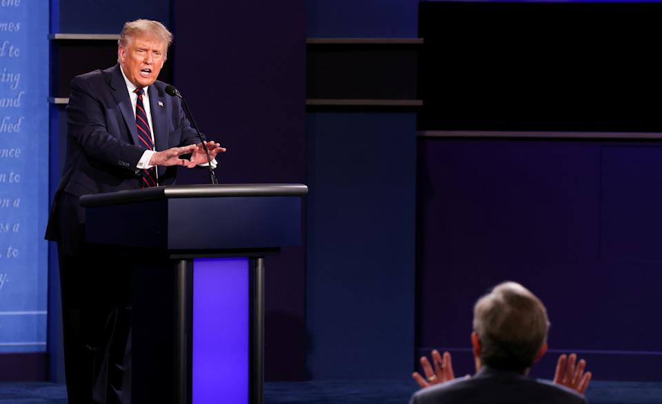 President Donald Trump argues with debate moderator Chris Wallace of Fox News Channel during the first 2020 presidential campaign debate with Democratic presidential nominee Joe Biden held on the campus of the Cleveland Clinic at Case Western Reserve University in Cleveland, Ohio, U.S., September 29, 2020. REUTERS/Jonathan Ernst     TPX IMAGES OF THE DAY