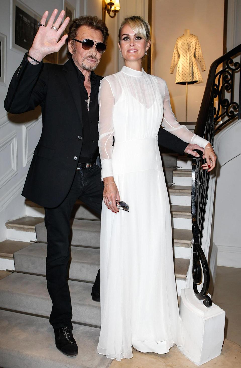 <p>French music legend Johnny Hallyday and his wife also attended the Dior show. <i>[Photo:PIXELFORMULA / SIPA/SIPA/REX/Shutterstock]</i></p>