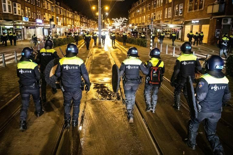 At least 400 people have now been arrested after the Netherlands imposed the first nationwide curfew since World War II