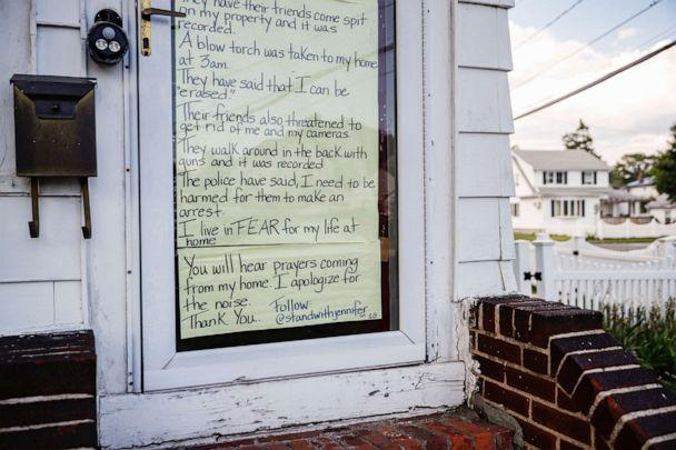 PHOTO: A sign taped the to the front door of the home of Jennifer McLegggan, who is Black and says she fears for her life due to racial animus in her neighborhood, July 13, 2020, in Valley Stream, N.Y. (John Minchillo/AP)