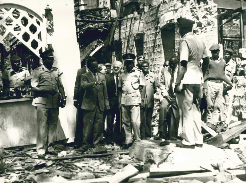 In this photo taken Jan. 1, 1981 security personnel and officials assess the damage after a bomb attack in which 20 died at the Norfolk Hotel in Nairobi, Kenya. The attack on the Norfolk Hotel, popular among foreign tourists, preceded the Sept. 21, 2013 assault on the Westgate Mall in Nairobi by a generation but then as now, a city landmark was hit, Kenyan and foreign civilians died, leaders pledged to stop it happening again and talk turned to recovery. (AP Photo)
