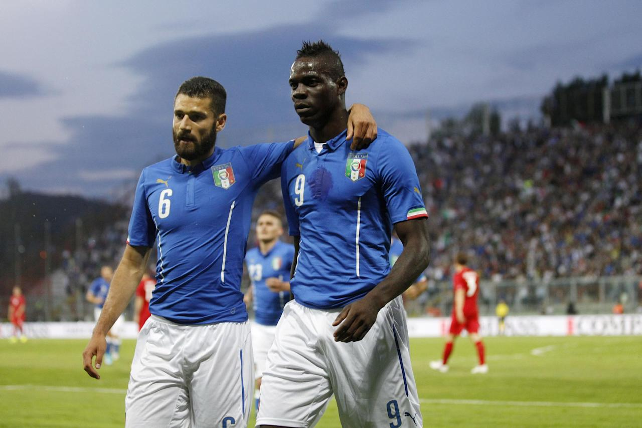 Italy forward Mario Balotelli, right, and teammate midfielder Antonio Candreva walk on the field after their teammate Claudio Marchisio scored during a friendly World Cup preparation soccer match between Italy and Luxembourg in Perugia, Italy, Wednesday, June 4, 2014. Italy opens its Brazilian World Cup campaign against England in Group D on June 14 then faces Costa Rica on June 20 and Uruguay on June 24. (AP Photo/Luca Bruno)