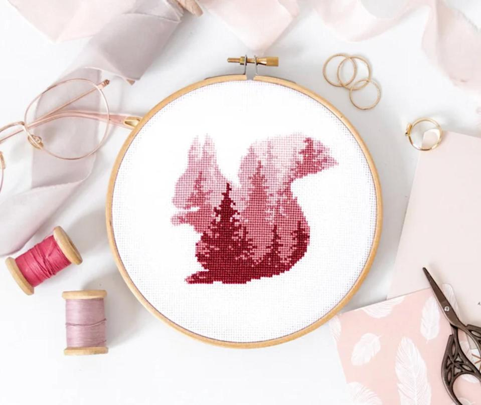 """<p>Design a creature of your choice—whether it's a wolf, a bear, a bunny, or, in this case, a bushy-tailed squirrel. These patterns are in vibrant colors and, if you look closely, reflect the densely forested landscape of their natural habitat.</p> <p><strong><em>Shop Now:</em></strong><em> Velvet Pony Design Cross Stitch Squirrel Forest Silhouette Kit, $27, <a href=""""https://www.awin1.com/cread.php?awinmid=6220&awinaffid=272513&clickref=MSL10ofOurFavoriteCrossStitchKitsforBeginnersaharperDIYGal7998715202010I&p=https%3A%2F%2Fwww.etsy.com%2Flisting%2F680417890%2Fsquirrel-silhouette-cross-stitch-kit%3Fref%3Dshop_home_active_43%26amp%3Bpro%3D1"""" rel=""""nofollow noopener"""" target=""""_blank"""" data-ylk=""""slk:etsy.com"""" class=""""link rapid-noclick-resp"""">etsy.com</a></em><em>.</em></p>"""