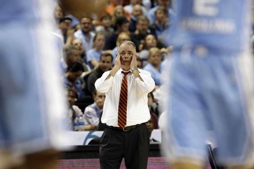 Virginia Tech head coach Mike Young reaqcts during the second half of an NCAA college basketball game against North Carolina at the Atlantic Coast Conference tournament in Greensboro, N.C., Tuesday, March 10, 2020. (AP Photo/Gerry Broome)