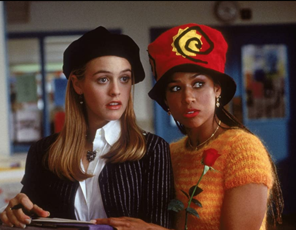<p>In addition to her ::chef's kiss:: wardrobe in <em>Clueless, </em>Stacey Dash's red lip stole the freakin' show. She wears it here with a, um, we guess we'd describe it as a...clip art-inspired hat? As one does in the '90s.</p>