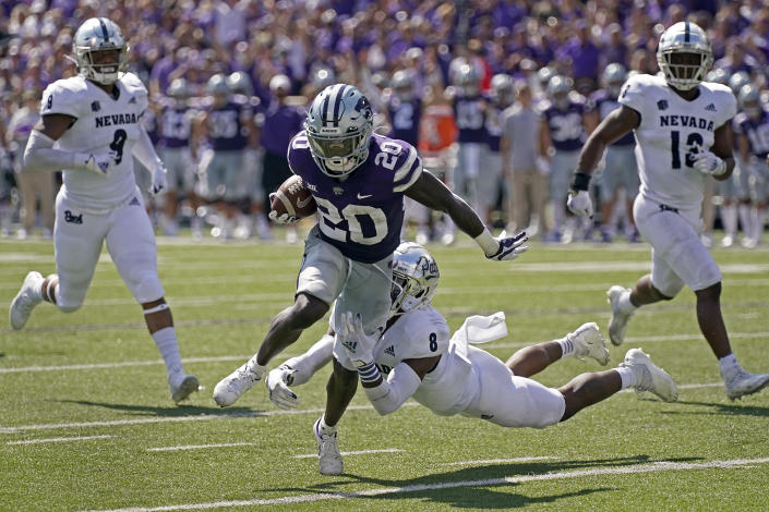 Kansas State running back Joe Ervin (20) gets past Nevada defensive back JoJuan Claiborne (8) to score a touchdown during the first half of an NCAA college football game Saturday, Sept. 18, 2021, in Manhattan, Kan. (AP Photo/Charlie Riedel)