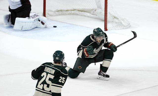 Minnesota Wild left wing Zach Parise (11) reacts after scoring on Colorado Avalanche goalie Semyon Varlamov during the third period of Game 6 of an NHL hockey first-round playoff series in St. Paul, Minn., Monday, April 28, 2014. The Wild won 5-2. (AP Photo/Ann Heisenfelt)
