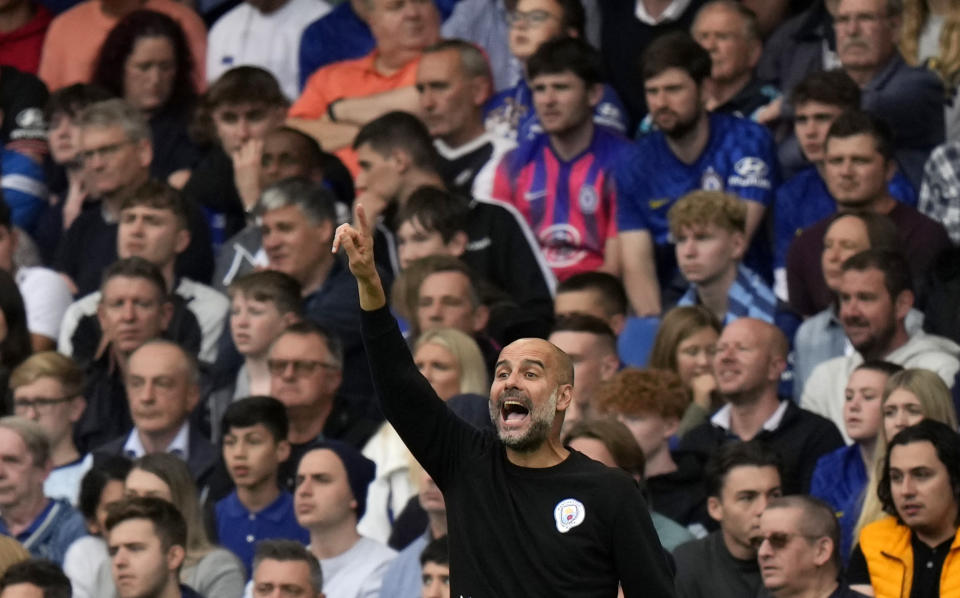 Manchester City's head coach Pep Guardiola gives directions to his players during the English Premier League soccer match between Chelsea and Manchester City at Stamford Bridge Stadium in London, Saturday, Sept. 25, 2021. (AP Photo/Alastair Grant)