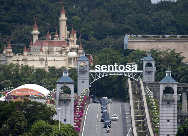 <p>Seen from the Bay Hotel in Singapore, a motorcade carrying North Korean leader Kim Jong Un leaves Sentosa Island where the summit between him and President Donald Trump took place at the Capella Hotel Tuesday, June 12, 2018, in Sentosa, Singapore. (Photo: Gemunu Amarasinghe/AP) </p>