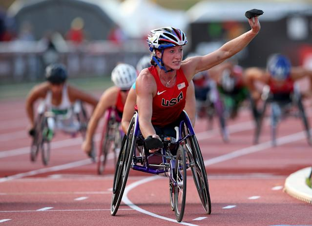 LYON, FRANCE - JULY 21: Tatyana McFadden of USA celebrates winning the Women's 5000m T54 final during day two of the IPC Athletics World Championships on July 21, 2013 in Lyon, France. (Photo by Julian Finney/Getty Images)