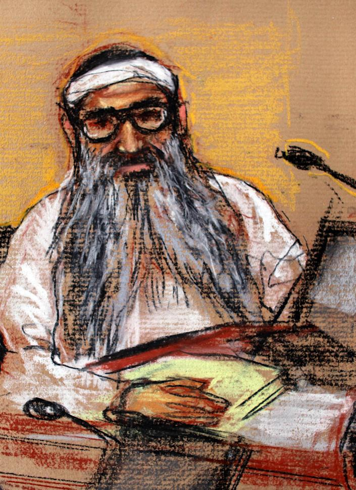 FILE - In this Jan. 19, 2009 file courtroom sketch by artist Janet Hamlin, reviewed by the U.S. Military, 9/11 attacks co-defendant Khalid Sheikh Mohammed sits during a hearing at the U.S. Military Commissions court for war crimes, at the U.S. Naval Base, in Guantanamo Bay, Cuba. Mohammed is one of five men who will be tried at the U.S. Navy Base in Guantanamo Bay, Cuba, for planning and aiding the Sept. 11 attacks, charging them with war crimes in a special tribunal for wartime offenses known as a military commission.(AP Photo/Janet Hamlin, Pool, File)