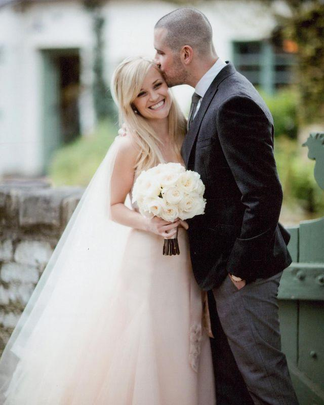 "<p>Looking radiant with her wide smile, Reese went for a subtle hint of colour in her blush pink gown when she exchanged vows with talent agent Jim Toth for their country ranch wedding. </p><p><a href=""https://www.instagram.com/p/CM5GeXuALVf/?utm_source=ig_embed"" rel=""nofollow noopener"" target=""_blank"" data-ylk=""slk:See the original post on Instagram"" class=""link rapid-noclick-resp"">See the original post on Instagram</a></p>"