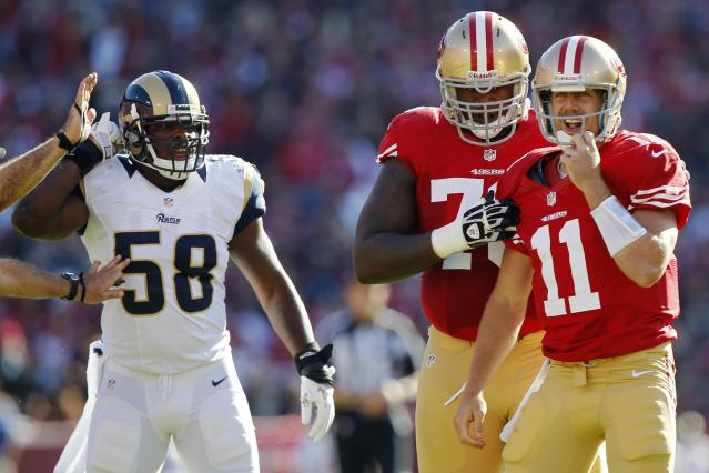 SAN FRANCISCO, CA - NOVEMBER 11: Quarterback Alex Smith #11 of the San Francisco 49ers adjusts his helmet after getting hit by linebacker Jo-Lonn Dunbar #52 of the St. Louis Rams during a run in the first quarter on November 11, 2012 at Candlestick Park in San Francisco, California. (Photo by Brian Bahr/Getty Images)